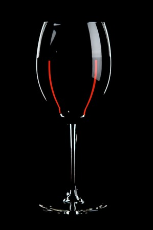glass with red wines on the black background