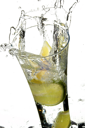 glass with water and lemon on the white background