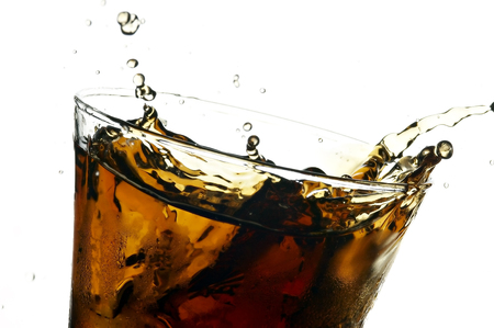 cola in glass on the white background photo