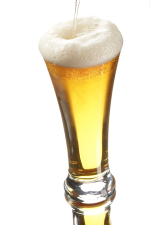 bleb: Beer in glass on the white background Stock Photo