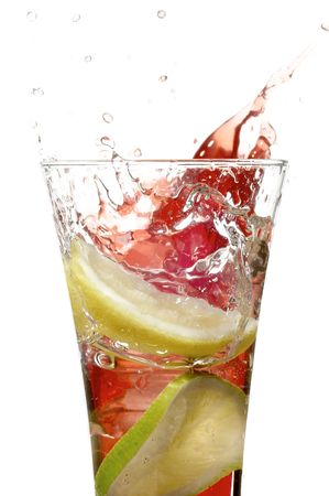 glass with juice and lime on the white background  Stock Photo
