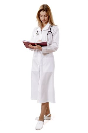 young doctor with book on the white background