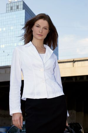 Young businesswoman in front of an office building