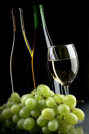 pervaded: still life with grape and wines on the black background Stock Photo