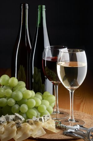 still life with grape, cheese, red and white wines on the black background Stock Photo - 1743973