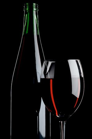 pervaded: still life with red wines on the black background