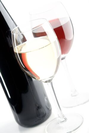 pervaded: still life with red and white wines on the white background