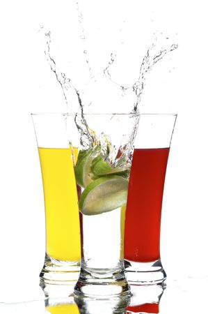 glass with juice and lemon on the white background photo