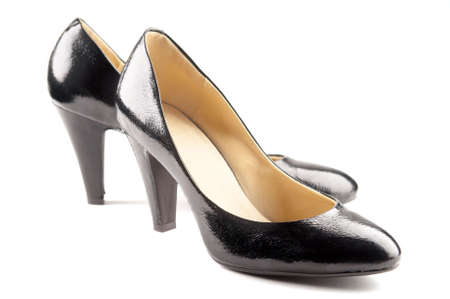 loafer: Black patent-leather shoes on white background