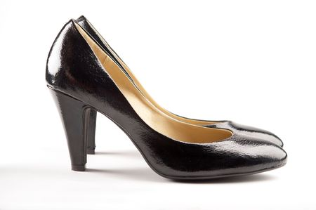Black patent-leather shoes on white background photo