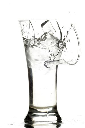 and worn out: glass with water on the white background