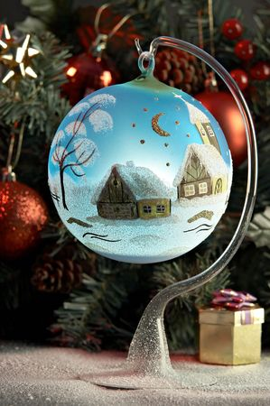 Blue ball in front of fir tree