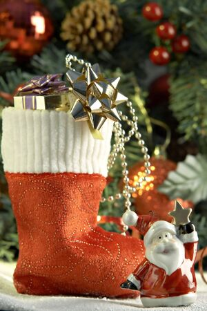 Cristmas stocking with presents in front of fir tree Stock Photo - 2083288