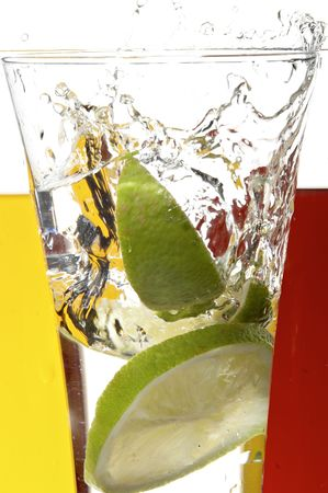 glass with juice and lemon on the white background Stock Photo