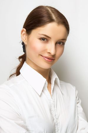 Young woman on the white background Stock Photo - 2400134