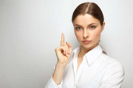 Young woman on the white background