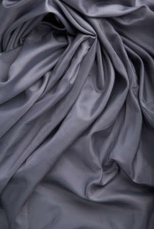 abstract background grey silk fabric with waves