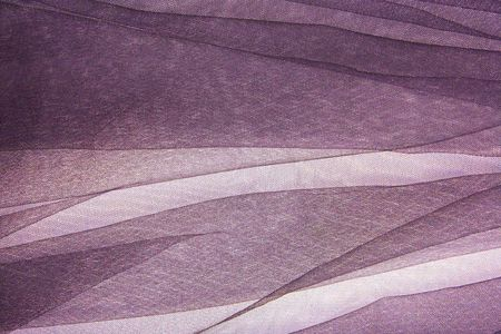 abstract background violet veil fabric with waves Stock Photo