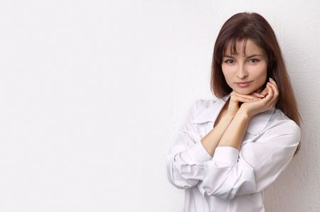 Young woman on the white background photo