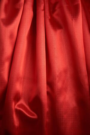 abstract background red silk fabric with waves