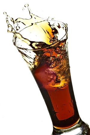 glass with cola on the white background