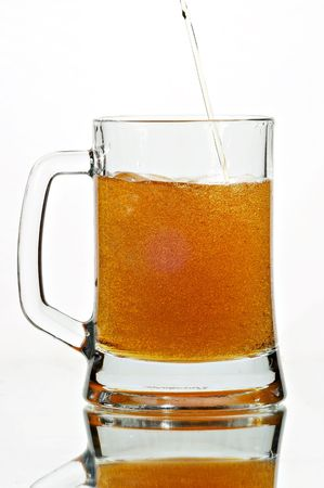 Beer in glass on the white background photo