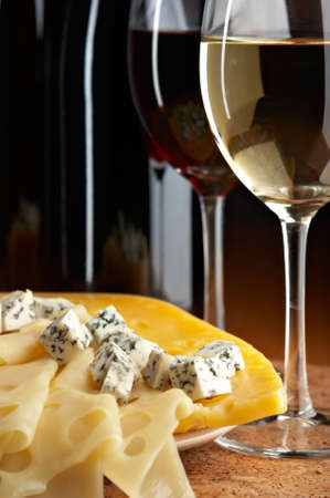 pervaded: still life with cheese and wine on the black background