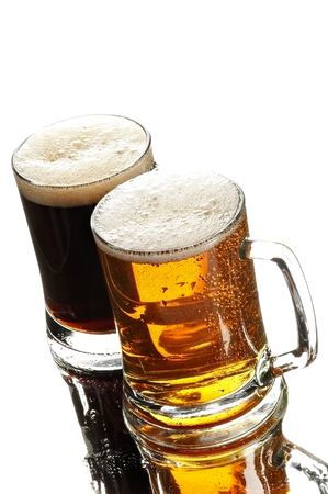two beers in glasses on the white background photo