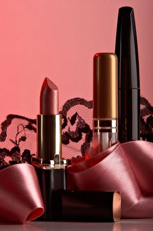 still life with cosmetics on the rose background Stock Photo