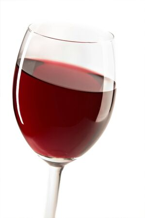 glass with red wine on the white background