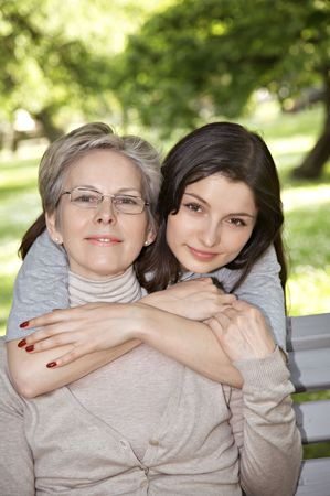 Mother and daughter on the walk in park Stock Photo
