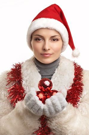 Young beautiful woman in fur coat and red hat with balls  on the white background