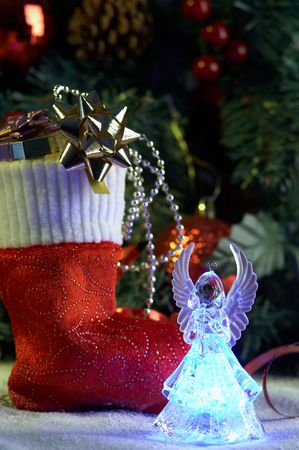Angel and christmas stocking with presents in front of fir tree Stock Photo - 3904067