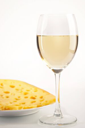 still life with white wine and cheese on the white background Stock Photo