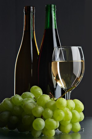 still life with grape and wines on the black background Stock Photo
