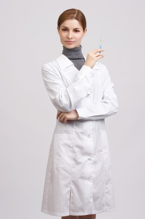 Young beautiful doctor on the white background photo