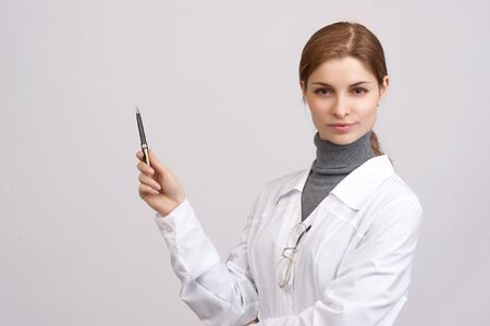 Young beautiful doctor on the white background