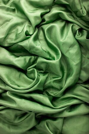 satiny: abstract background green silk fabric with waves Stock Photo