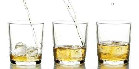 glass with whiskey on the white background