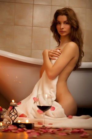 Young beautiful woman in the retro bathroom photo