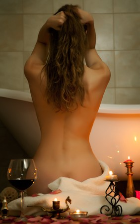 Young beautiful woman in the retro bathroom