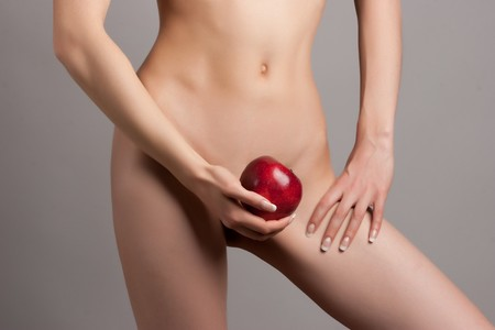 silhouette of young beautiful woman with red apple on the white background