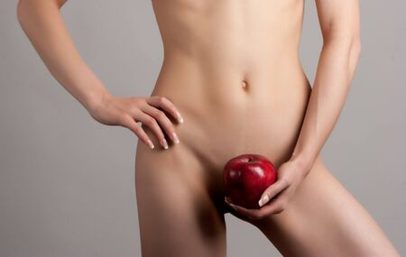 silhouette of young beautiful woman with red apple on the white background photo