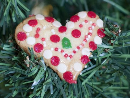 Christmas Cookie Heart hung on a Christmas tree