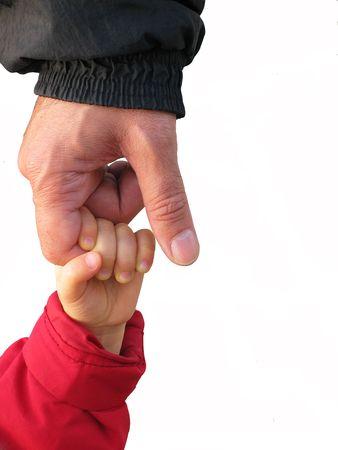 peuter bereiken up te houden van zijn vaders hand, geïsoleerd op wit Stockfoto