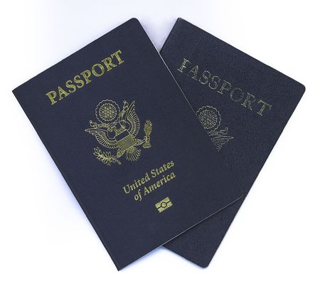 New US Passport with Chip over old heavily used passport Фото со стока