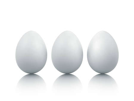 three eggs on white background with reflections