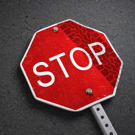 broken stop sign with track trace Stock Photo