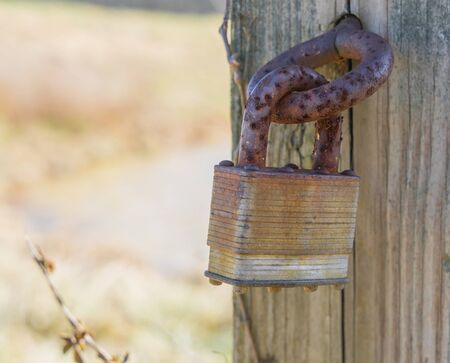 nowhere: Rusty lock that does not lock anything in the middle of nowhere