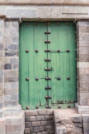 cusco: Green door with rusty ornaments in Cusco, Peru